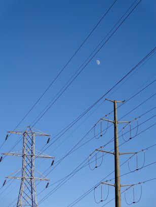 electric-power-lines-with-blue-sky-and-daytime-moon