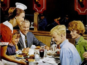 waitress-serving-food-to-family-at-restaurant_074602