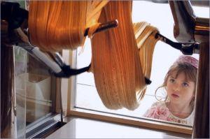 Girl-looking-through-window